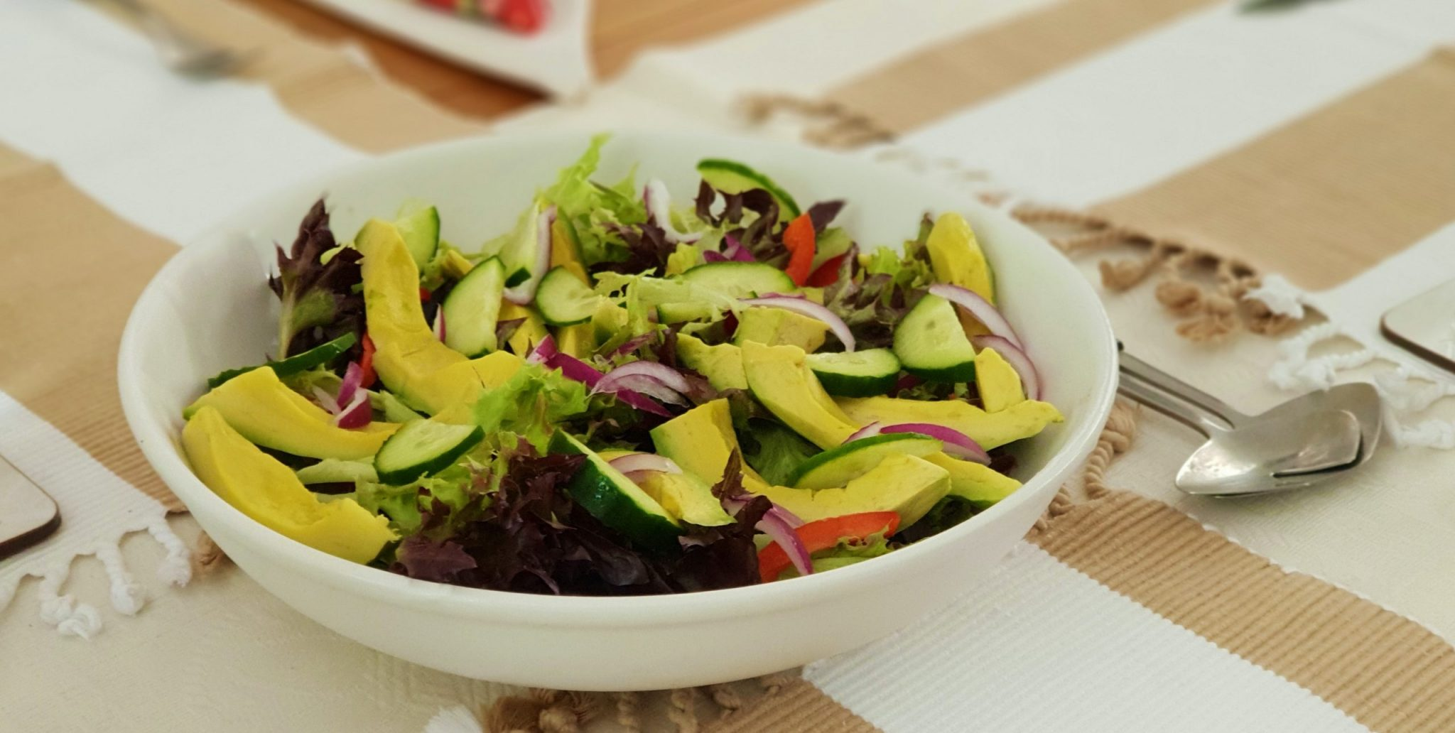 Fresh market salad in a white bowl