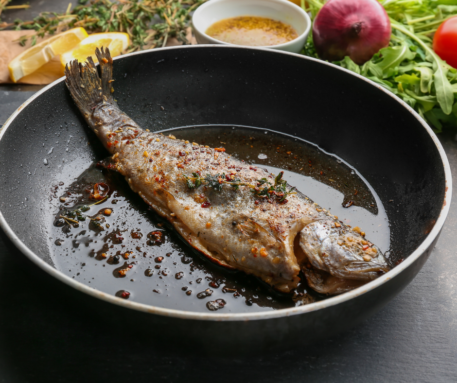 Pan-seared trout in a pan